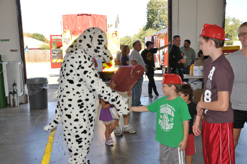 Sparky the Fire Dog visiting with the kids