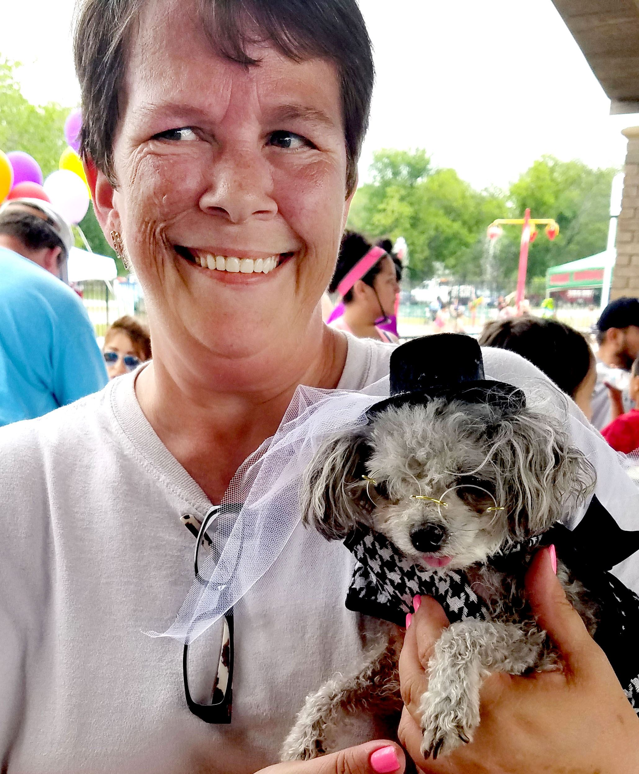 Woman Holding Costumed Dog at Bark in the Park